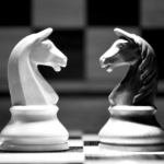 two chess knights facing each other on a chess board - benefits of mediation