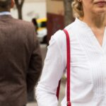 Mn and woman walking away from each other - spousal support mediation