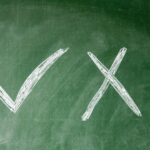 green chalkboars with a large X and checkmark - 4 Misconceptions About Mediation in Divorce